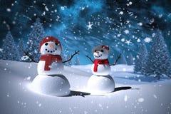 Sammansatt bild av snögubbefamiljen Royaltyfri Foto