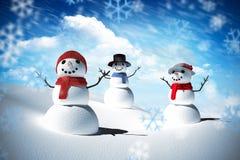 Sammansatt bild av snömanfamiljen Arkivfoto