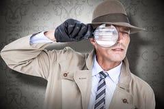 Sammansatt bild av spionen som ser till och med förstoringsapparaten Royaltyfri Bild
