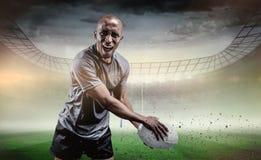 Sammansatt bild av ståenden av den aggressiva idrottsmannen som spelar rugby Arkivbilder