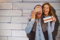 Sammansatt bild av ståenden av kvinnan som ger överraskninggåvan till mannen Fotografering för Bildbyråer