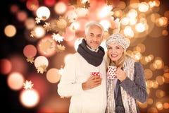 Sammansatt bild av ståenden av lyckliga par som dricker varmt kaffe Arkivbilder