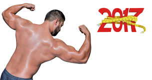 sammansatt bild 3D av kroppsbyggaremannen som böjer hans muskler Fotografering för Bildbyråer