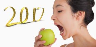 sammansatt bild 3D av kvinnan som biter in i äpplet Royaltyfria Bilder