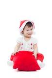 Sammanträde och le för flicka för lycklig jul Royaltyfri Fotografi