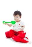 Sammanträde och spela för flicka för lycklig jul Royaltyfria Bilder