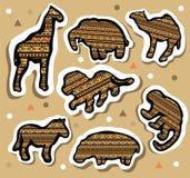 Sammlung afrikanische Tieraufkleber mit nahtlosem Muster Lizenzfreie Stockfotografie