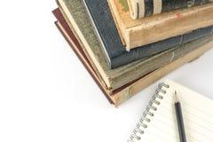 Sammlung alte Bücher auf Weiß Stockfotografie