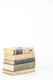 Sammlung alte Bücher auf Weiß Stockbilder