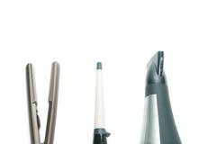 Sammlung des flachen Eisens, der Brennschere und des Haartrockners Lizenzfreie Stockfotos