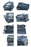 Sammlung gefaltete alte Blue Jeans lokalisiert auf einem Weiß Lizenzfreie Stockfotografie