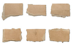 Sammlung zerrissene braune Stücke Pappe, Schatten Lizenzfreies Stockbild