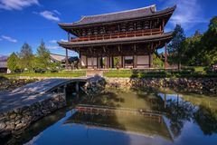 Sammon Gate of Tofukuji temple, Kyoto. Sammon Gate bridge entrance with skyline reflection on pond with blue clear sky of Tofukuji Temple in Kyoto Japan. Kansai Royalty Free Stock Photos