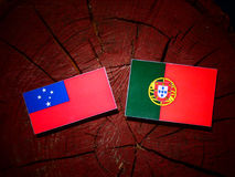 Samoa flag with Portuguese flag on a tree stump isolated. Samoa flag with Portuguese flag on a tree stump vector illustration