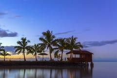 Samoa at sunset. Palm trees and beach hut at sunset on Samoa Royalty Free Stock Images