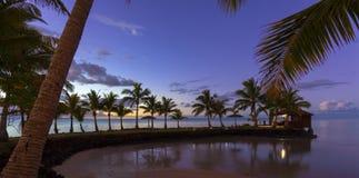 Samoa at sunset. Palm trees and beach hut at sunset on Samoa Royalty Free Stock Photos