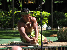 Samoan. POLYNESIAN CULTURAL CENTER, OAHU, HI: 2007/16/08., Samoan is trying to light a fire royalty free stock photo