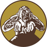 Samoan God Tagaloa Arms Out Circle Woodcut. Illustration of Samoan legend god Tagaloa facing front with arms out set inside circle done in retro woodcut style Royalty Free Stock Photo