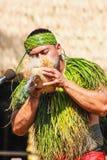 A Samoan Man demonstrating how to start fire using a coconut. Honolulu, Hawaii - May 27, 2016:A Samoan Man demonstrating how to start fire using a coconut at stock photo