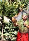 :A Samoan Man demonstrating how to start fire using a coconut. Honolulu, Hawaii - May 27, 2016:A Samoan Man demonstrating how to start fire using a coconut at stock photos