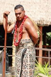 A Samoan Man poses for photos in the Village of Samoa at the Polynesian Cultural Center. Honolulu, Hawaii - May 27, 2016:A Samoan Man poses for photos in the stock photos