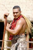 Samoan Man poses for photos in the Village of Samoa at the Polynesian Cultural Center. Honolulu, Hawaii - May 27, 2016:A Samoan Man poses for photos in the stock photos