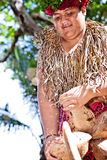 Samoan is opening coconut. Samoan is showing how to open a coconut for tourist. Photo taken on: September 29th, 2012, Oahu, Hawaii royalty free stock images