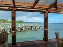 Samoan Resort on Ocean with rainbow Stock Photo