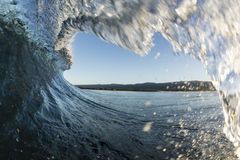 Samoan Wave. A perfect surfing wave pitching out in Samoa, at dawn stock photography