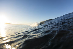 Samoan Wave. A perfect surfing wave pitching out in Samoa, at dawn stock images