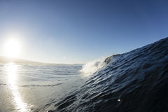 Samoan Wave. A perfect surfing wave pitching out in Samoa, at dawn stock photos