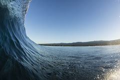Samoan Wave. A perfect surfing wave pitching out in Samoa, at dawn royalty free stock photo