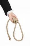 Samobójstwa i biznesu temat: Ręka biznesmen trzyma pętlę odizolowywająca arkana dla wieszać na bielu w czarnej kurtce Zdjęcie Stock