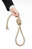 Samobójstwa i biznesu temat: Ręka biznesmen trzyma pętlę odizolowywająca arkana dla wieszać na bielu w czarnej kurtce Fotografia Stock