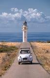 samochód i latarnia morska Zdjęcia Royalty Free