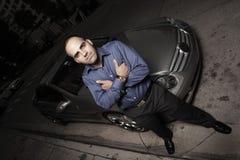 samochód jego luksusowy mężczyzna bawi się ulicę Obrazy Stock