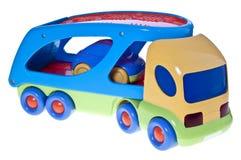samochód odizolowywający zabawkarski transporteru biel Zdjęcie Stock