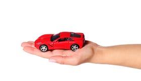 Samochód w żeńskiej ręce odizolowywającej na białym tle Obrazy Royalty Free