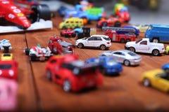 Samochód zabawki na drewnianym tle Obrazy Royalty Free