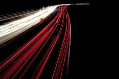 Samochodowe lekkie linie na autostradzie podczas ruchu drogowego dżemu przy nocą Zdjęcie Royalty Free