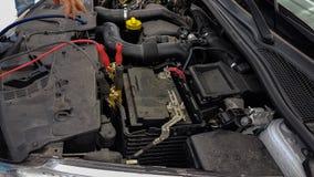 Samochodowej baterii sznurów ładuje tło Fotografia Stock