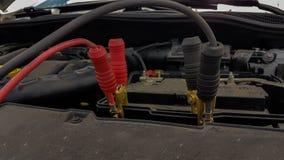 Samochodowej baterii sznurów ładuje tło Zdjęcie Stock