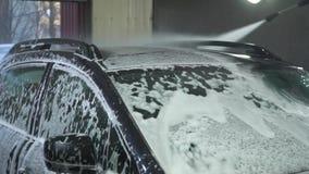 samochodowy czysty wąż elastyczny maszyny gąbki obmycie Samochodowa płuczka myje samochód Samochód zakrywa z białą domycie pianą  zbiory