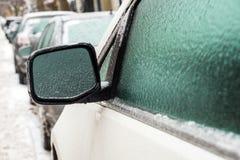 Samochodowy lustro i okno zakrywamy z lodem po marznięcie deszczu Obraz Royalty Free