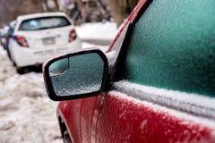 Samochodowy lustro i okno zakrywamy z lodem po marznięcie deszczu Obrazy Royalty Free