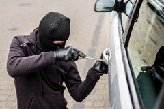 Samochodowy złodziej, samochodowa kradzież Zdjęcie Stock