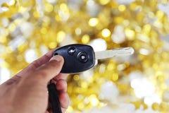 Samochodu klucz na złota i srebra tle Obraz Stock