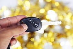 Samochodu klucz na złota i srebra tle Zdjęcia Stock