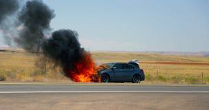 Samochodu ogień na stronie droga Obrazy Royalty Free