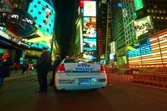 Samochodu policyjnego kwadrat przy nocą czasami Zdjęcie Stock